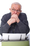 Senior and typewriter Royalty Free Stock Photo
