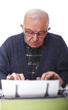 Senior with typewriter Stock Photos