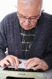 Senior at typewriter Royalty Free Stock Photography
