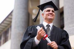 Senior university graduate. Optimistic senior university graduate in front of college building Stock Image