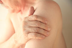 Senior with upper arm pain stock photography