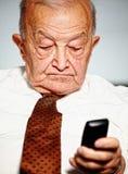 Senior use mobile Royalty Free Stock Photo