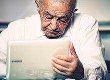 Senior use pc Stock Photo