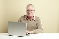 Senior using laptop Royalty Free Stock Photos