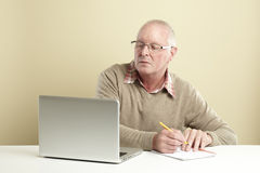 Senior using laptop Royalty Free Stock Photos