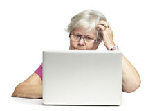 Senior using laptop Royalty Free Stock Image