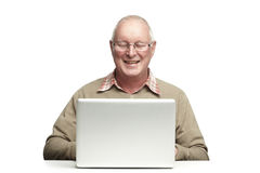 Senior using laptop Stock Photos