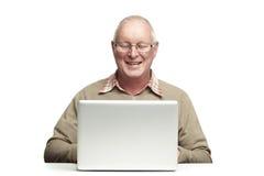 Senior using laptop Stock Photos