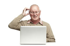 Senior using laptop Stock Images