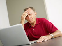 Senior using laptop computer Stock Images