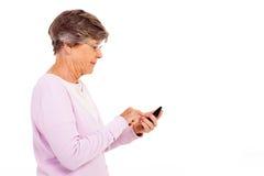 Senior using smart phone stock photos