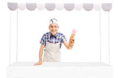 Senior vendor giving an ice cream Royalty Free Stock Images