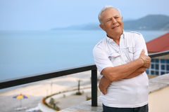 Senior on veranda near seacoast Royalty Free Stock Photos