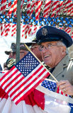 Senior Veteran soldier waves flag Royalty Free Stock Photos