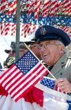 Senior Veteran soldier waves flag Royalty Free Stock Photos