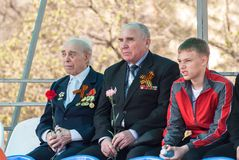Senior veterans of World War II and boy on tribune Stock Photography