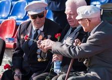 Senior veterans of World War II meet on tribunes Stock Images