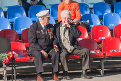 Senior veterans of World War II meet on tribunes Royalty Free Stock Image