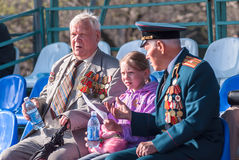 Senior veterans of World War II on tribune Stock Image