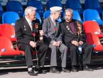 Senior veterans of World War II on tribune Royalty Free Stock Photo