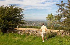 Senior viewing over Winchcombe from Belas Nap Stock Image