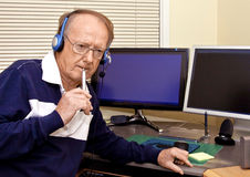 Senior volunteer answering phone calls 4 Royalty Free Stock Photography