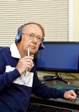 Senior volunteer answering phone calls 7 Stock Images