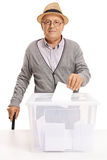 Senior voting and looking at the camera Stock Photography