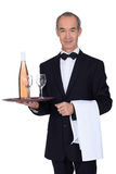 Senior waiter holding tray Royalty Free Stock Image