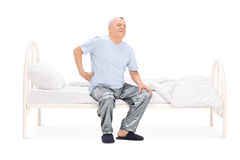 Senior waking up with a pain in his back Stock Images