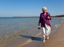 Senior Walking on the Beach Horizontal Royalty Free Stock Photo