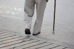 Senior with Walking Stick. Royalty Free Stock Image
