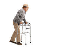 Senior walking with a walker Royalty Free Stock Image