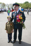 Senior war veteran and a boy. Victory Day celebration in Moscow. Royalty Free Stock Photography