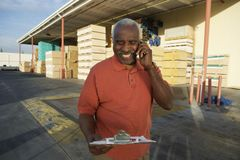 Senior Warehouse Worker On A Call Royalty Free Stock Image