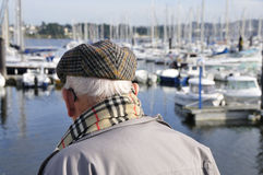 Senior watching boats Royalty Free Stock Image