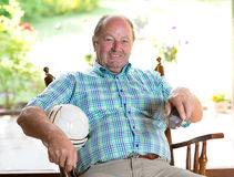 Senior watching soccer match in the tv Stock Image