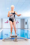 Senior in water gymnastics therapy royalty free stock photos