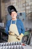 Senior welding worker in workshop Stock Photo