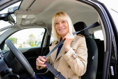 Senior At the Wheel  putting seatbelts Royalty Free Stock Images