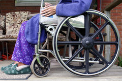 Senior in Wheelchair. The lower half of an elderly, senior citizen sitting in a wheelchair royalty free stock image