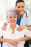 Senior wheelchair caregiver royalty free stock image