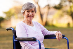 Senior wheelchair outdoors Stock Images