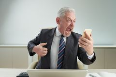 Senior White Collar Worker Relieving Stress Royalty Free Stock Images