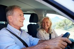 Free Senior White Man Driving Car, His Wife Beside Him In The Front Passenger Seat, Close Up, Side View Royalty Free Stock Photo - 153665445