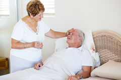 Senior wife comforting husband Royalty Free Stock Photo