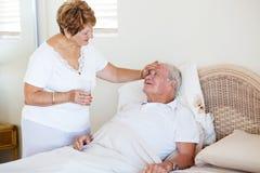 Senior wife comforting husband Royalty Free Stock Photo