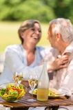 Senior wife and husband dining outdoors Stock Photography