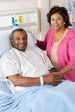 Senior Wife Visiting Husband On Ward Royalty Free Stock Photography
