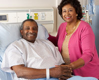 Senior Wife Visiting Husband On Ward Royalty Free Stock Images